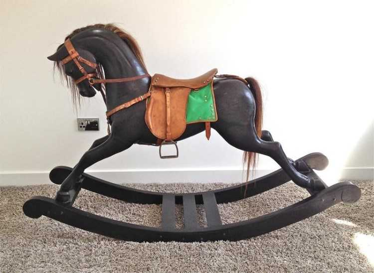 LOVELY LARGE ANTIQUE DARK WOOD ROCKING HORSE.