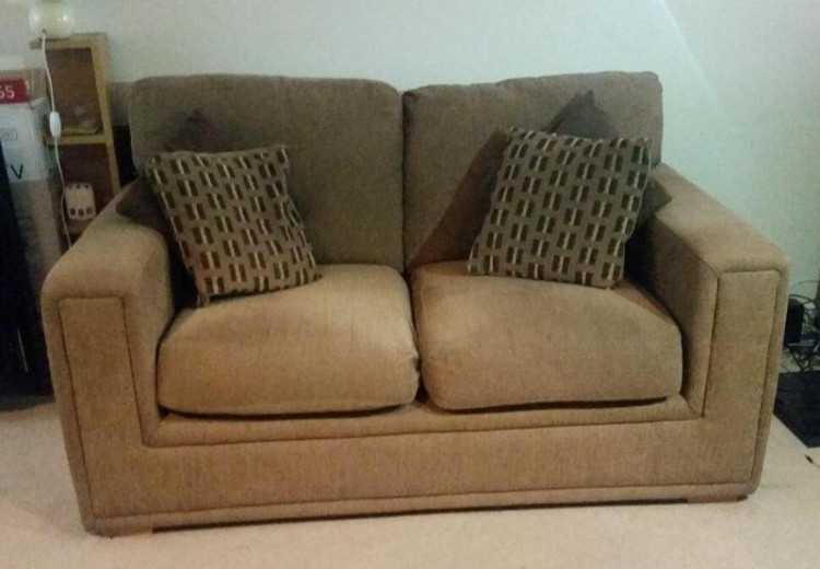 2 brown sofas - 8 cushions - great condition -