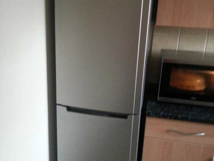 Large dark gray fridge and freezer
